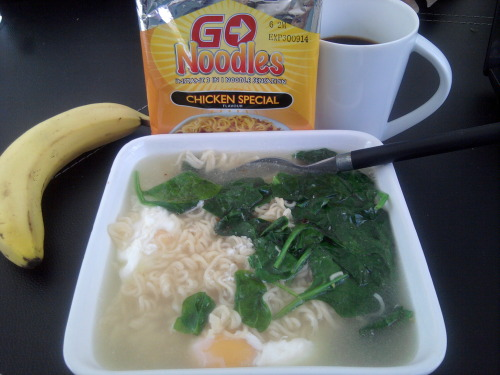 Tamikaze's London 4/27 bout-day breakfast:  Go noodles, spinach, poached eggs, Nescafe, and a bananaphone.
