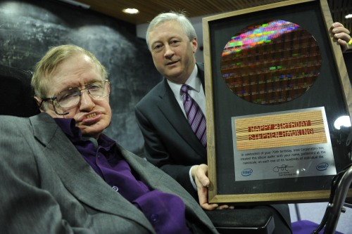"""When Hawking received it, he was pleased, honored and interested in how it was made,"" said Martin Curley, vice president of Intel Labs Europe, who presented Hawking with a one-of-a-kind wafer as a 71st birthday gift. The 300-millimeter silicon wafer that read ""Happy Birthday Stephen Hawking"" 100 times in letters 10 times smaller than the width of a human hair. The letters were etched on the wafer at Intel's Fab D1C in Hillsboro, Ore. employing the same 32-nanometer technology used for Intel smartphone chips.  Hawking said there are a lot of plaques in the halls of his research facility, but this one is going straight to his office, according to David Fleming, manager of the Intel Innovation Open Lab in Ireland. ""He also joked that his initials already appear in massive galactic graffiti visible in the afterglow of the Big Bang, referencing a NASA image from 2010, but now his name exists in the smallest of dimensions,"" said Fleming. The full story: Stephen Hawking Celebrates with Silicon."
