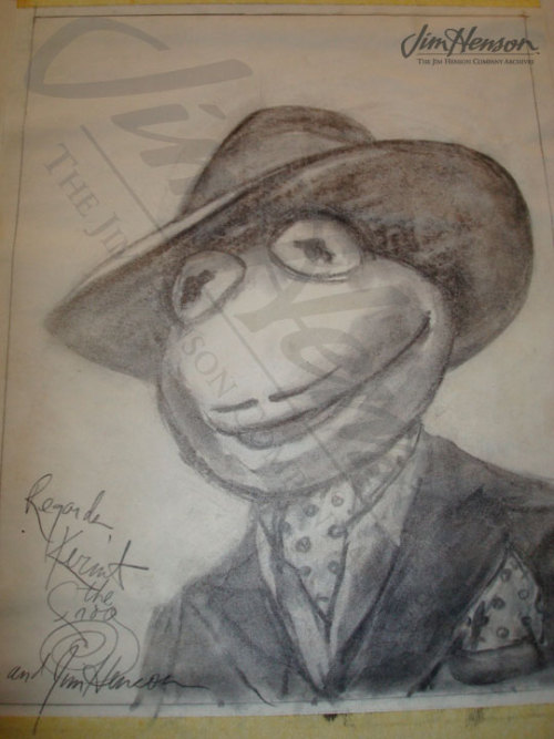 Kermit's faux Sardi's portrait showing him disguised as a Broadway producer in The Muppets Take Manhattan, 1983.