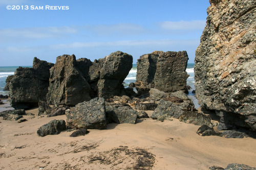 From this week's excursion along the San Mateo County coast. Several boulders and rocks pop out of the beach at Gazos Creek, just south of Pigeon Point, California. Stonehenge in the sea!