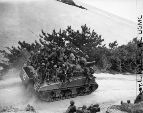 demons:  US Marines of the 6th Marine Division riding a Sherman on Okinawa, April 1945/PFC Robert L. Keller
