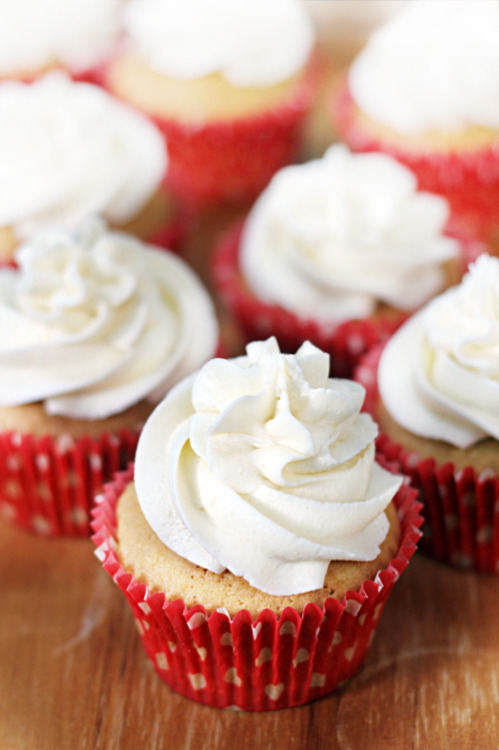 pineapple coconut cupcakes with coconut buttercream click here for recipe