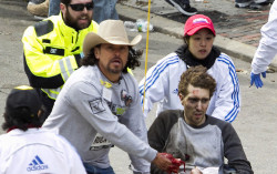 "shortformblog:  Jeff Bauman, the Boston Marathon bombing victim shown in the iconic image above, may have provided the break in the case that led to today's photo release, according to his brother Chris. More details from Bloomberg:  Just before 3 p.m. on April 15, Bauman was waiting among the crowd for his girlfriend to cross the finish line at the Boston Marathon. A man wearing a cap, sunglasses and a black jacket over a hooded sweatshirt looked at Jeff, 27, and dropped a bag at his feet, his brother, Chris Bauman, said in an interview. Two and a half minutes later, the bag exploded, tearing Jeff's legs apart. A picture of him in a wheelchair, bloodied and ashen, was broadcast around the world as he was rushed to Boston Medical Center. He lost both legs below the knee. ""He woke up under so much drugs, asked for a paper and pen and wrote, 'bag, saw the guy, looked right at me,'"" Chris Bauman said yesterday in an interview.  Bauman reportedly talked to the FBI in the days after the bombing. (photo by Kelvin Ma/Bloomberg) EDIT: In related news, a high-quality photo of ""Suspect #2,"" shot by a sportswear company executive, has surfaced. While questions of its veracity initially rose online, the photo is in fact legit."