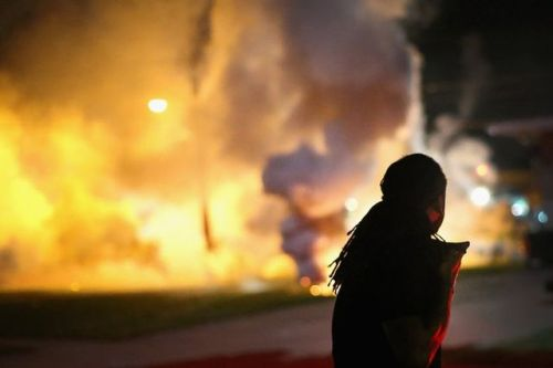sensei-aishitemasu:  Tear gas is banned in international warfare — and in use in Ferguson, MO  http://www.vox.com/2014/8/14/6001995/ferguson-missouri-tear-gas-painful  In case anyone didn't know, the use of tear gas was banned in international warfare at the Geneva Convention. These are human rights violations, people. Ferguson PD needs to be put in front of a UN board as war criminals. They are also arresting and detaining journalists.   Stay woke.  Hmmmm