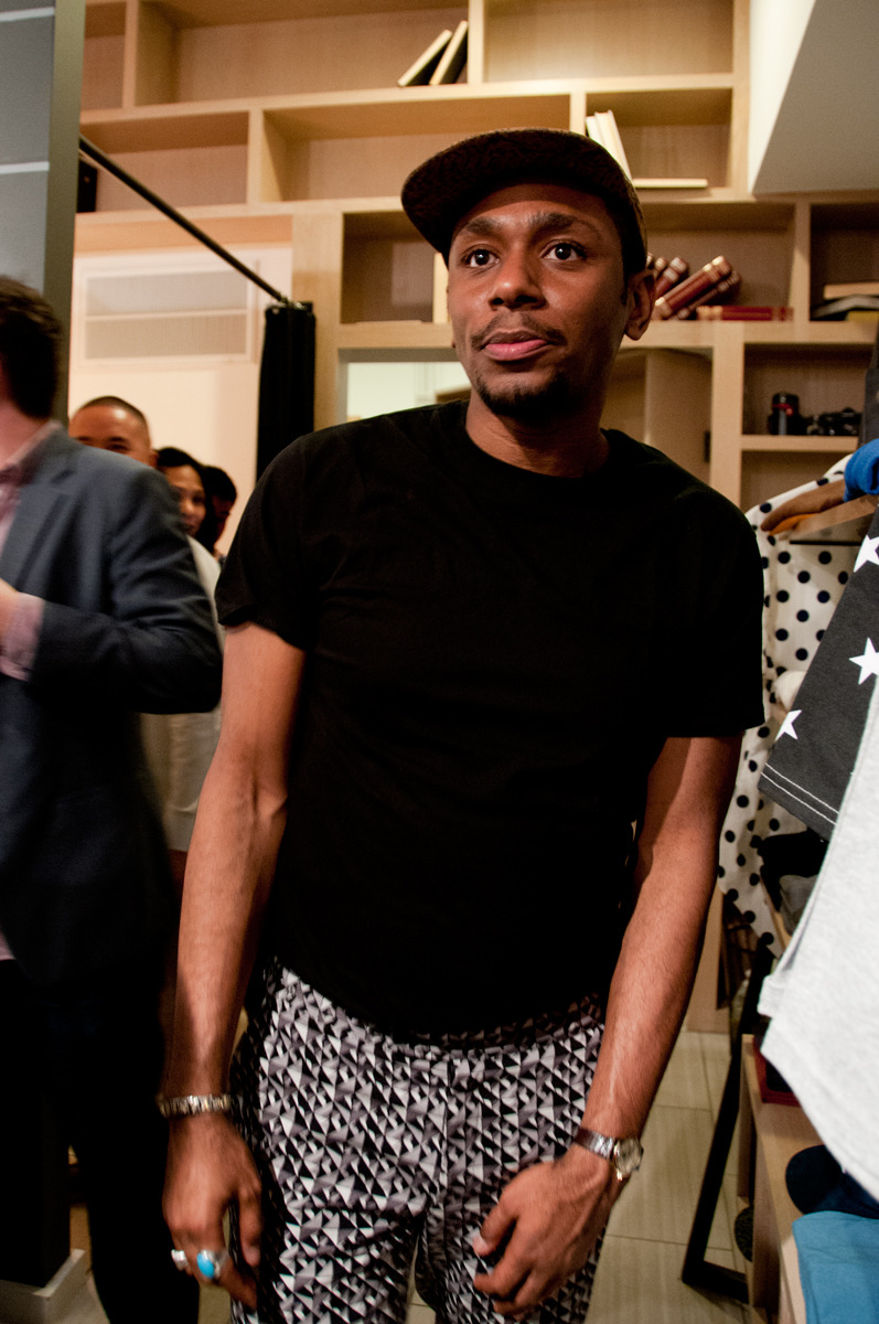 Yasiin Bey at the PF Flyers Pop Shop checking the event out in his patterned pants.
