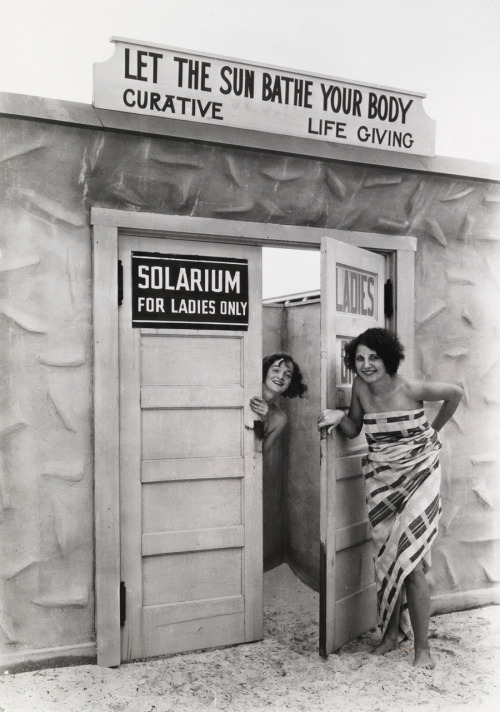 "natgeofound:  Bathing beauties emerge from a ""solarium"" (a tanning booth), in St. Petersburg, Florida, June 1929.Photograph by Clifton R. Adams, National Geographic"