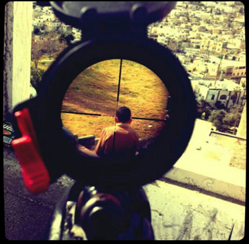 thedailywhat:  Resentment of the Day: An Israeli Soldier's Instagram of a Palestinian Boy  A chilling Instagram photo recently uploaded by an Israeli soldier of a presumably Palestinian boy in the crosshairs of a sniper rifle scope has sparked outrage on the web, even prompting an official investigation by the Israeli Defense Force within the sniper unit that the uploader has been assigned to. Mor Ostrovski, the 20-year-old soldier who uploaded the image, has since closed his Instagram account and defended his action by saying that he didn't take the photograph but simply found the photo on the Internet.