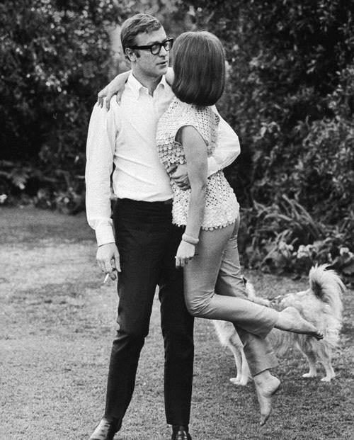 Michael Caine lifting Natalie Wood