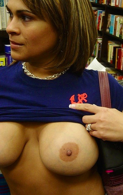 exposed-in-public:  In the library for Flashing Friday from http://exposed-in-public.tumblr.com/