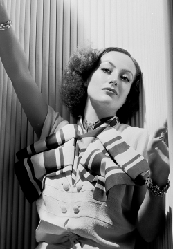 vintagechampagnefever:  The always amazingly dressed Joan Crawford