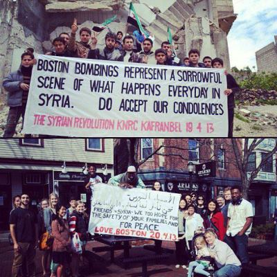 "In answer to Kafranbel's condolences, the people of Boston write a message in solidarity with them and their struggle. ""Boston, bombings represent a sorrowful scene of what happens everyday in Syria. Do accept our condolences."" 19/04/2013 ""Friends of Syria, we too hope for the safety of your families and for peace."" 20/04/2013"