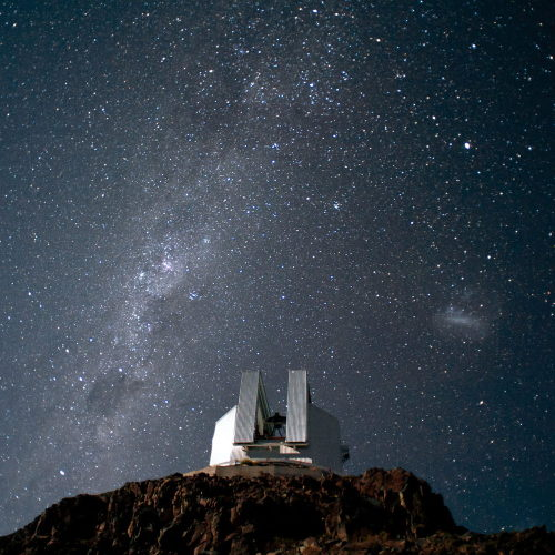 Credit: ESO/H. Dahle The 3.58-meter New Technology Telescope (NTT), located at ESO's La Silla Observatory in Chile, stands against the southern sky. The Milky Way appears as a hazy stripe across the sky. Also, the Large Magellanic Cloud appears to the right of the telescope.