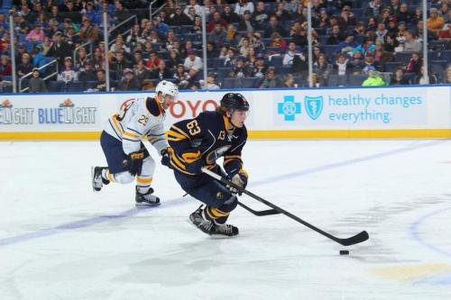 Tyler Ennis skating past Jason Pominville in what feels like an odd dream