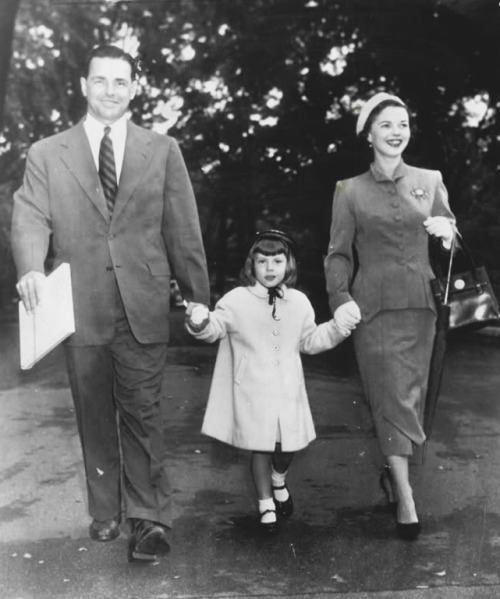 Shirley Temple, with husband Charles Black and daughter Linda Susan, on White House grounds, 1953.