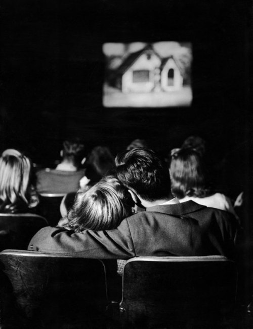 bygoneamericana:  A teenage couple at the movies, circa 1944. By Nina Leen