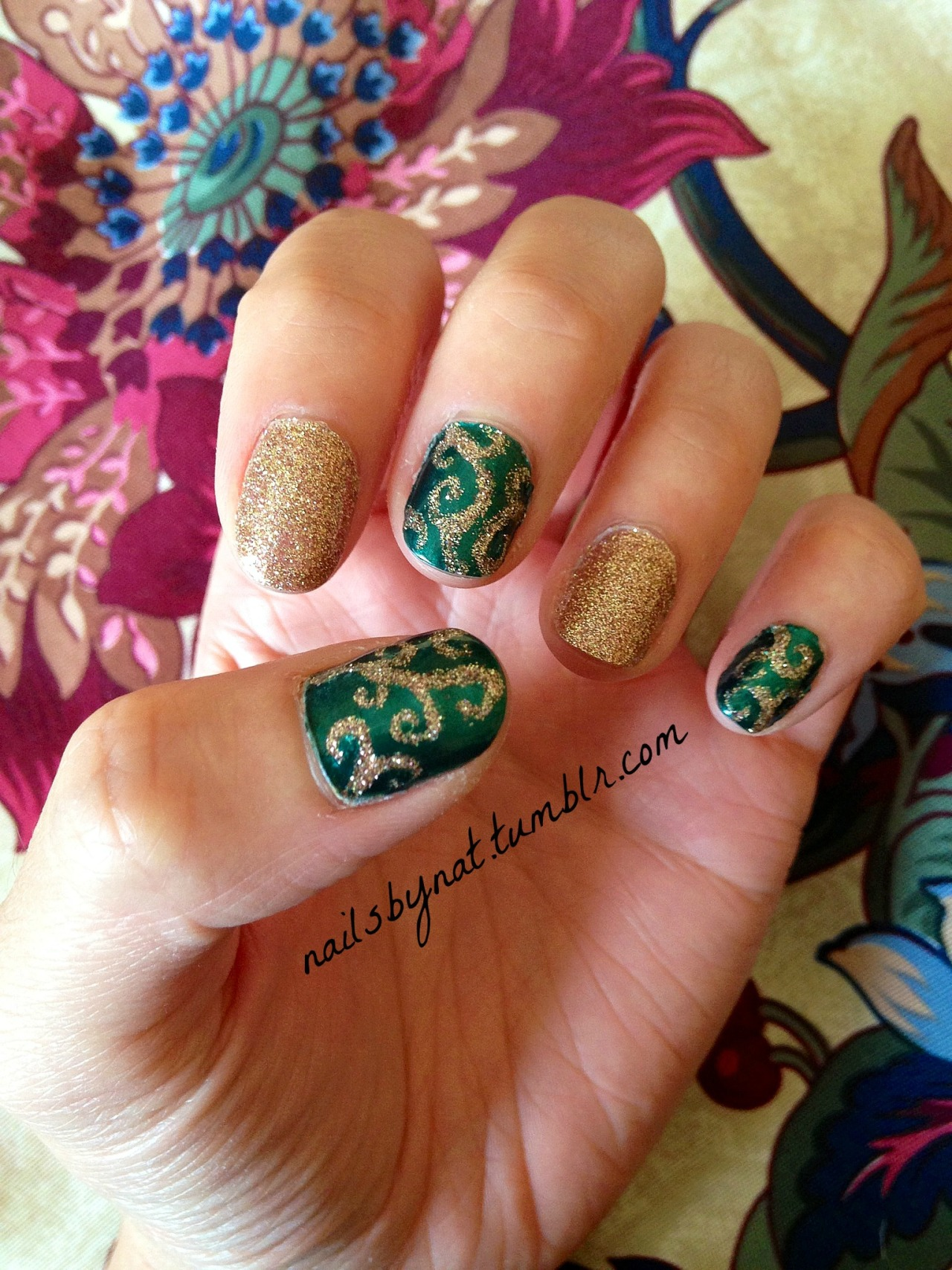 "nailsbynat:  So during winter break I did a little shopping and stopped by Sephora to buy my mom a birthday gift. I always love to look in the sale section too because they have really awesome stuff sometimes. I found this beautiful emerald green nail polish for only $5! This is just a little something I came up with :) 1/28/13 ———————————————————————————————————- Products used: Save The Nail ""Eau So Hydrated"" Base Coat Pantone Universe Jewel Lacquer nail polish in ""Evergreen"" China Glaze nail polish in ""Champagne Kisses"" Seche Vite Dry Fast Top Coat"