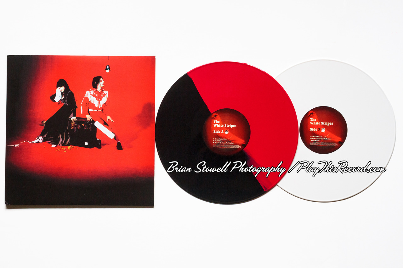 "The White Stripes | Elephant (10th Anniversary Reissue) | Third Man Records | AB: Black/Red split / CD: White I only have 7 days off between tours, so expect lots of record posts! I've been on tour for the past 4-5 Record Store Days, so I make my Dad do my bidding for me. He hits up some shops back in my hometown (Charlottesville, VA) that are less trafficked than those here in Portland and almost always finds all of the things I need. Thankfully this year's list was short. But this was first and foremost. Gotta satisfy the Jack White fanaticism. It just arrived in the mail an hour ago. Along with the Pornography 7"" (also have to satisfy the Ryan Adams fanboy) & Tift Merritt's Markings 12"". Side 1 of Elephant had some weird mix issues on ""There's No Home For You Here"", but the rest was awesome. Apologies for the watermark. Unless you're a a lazy eBay reseller."