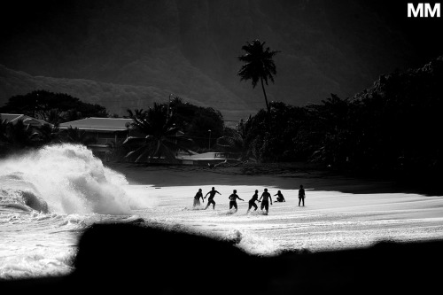 morganmaassen:  Preparing for the inevitable beating at a black sand shorebreak. Tahiti.