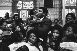 Muhammed Ali kissing a young girl, 1983, Chicago, Illinois. Photograph by Richard Gordon. Want a copy of this photo?  > Visit our Rights and Reproductions Department and give them this number: iCHi-36027 Connect with the Museum