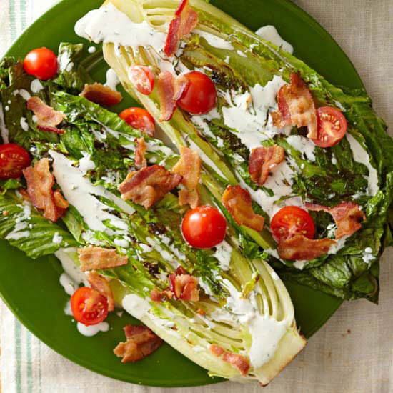 bhgfood:  BLT Salad with Buttermilk Dressing: Top grilled romaine with bacon, tomatoes, and tasty dressing for this sandwich-inspired salad.