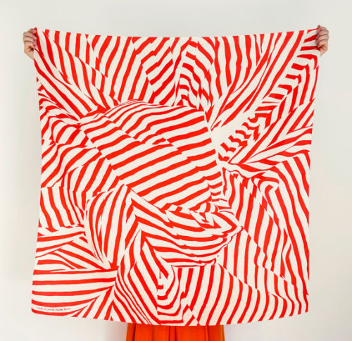 "Japanese ""furoshiki"" scarf designed by The Link Collective, a pair of collaborators on opposite sides of the world. Bonus: they also sell special straps and instructions for converting your scarf into a handbag. Brilliant."