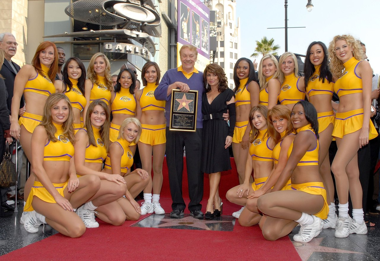 nba:  Dr. Jerry Buss poses with former Laker girl Paula Abdul and the current Laker Girls after Buss is honored with a television star on the Hollywood Walk of Fame on October 30, 2006 in Hollywood, California.  (Photo by Andrew D. Bernstein/NBAE/Getty Images)  Awesome