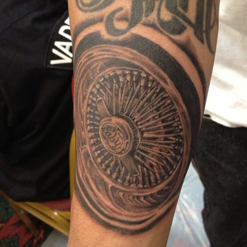 Today's tattoo At @tucsontattooexpo #dayton #wirewheel #tattoo #lowrider #4forty4tattoo #henrytattooer