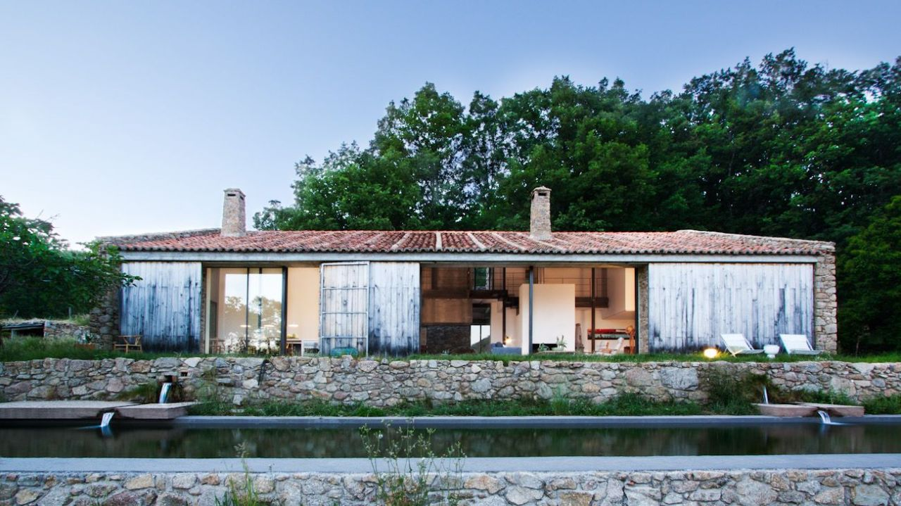 cabinporn:  Abandoned stable turned family dwelling in Cáceres, Spain designed by architecture firm ÁBATON. The building's southern orientation and lucky position below two potable streams allow the residents to live entirely off the grid year round. More photos.