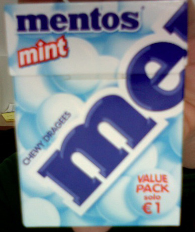 "Items from Old Gary's desk:  The Italian box of Mentos.  OG loves these because he can pretend they're a box of cigarettes, and because they read ""Chewy Dragees"".  They're almost all gone because YR ate most of them."