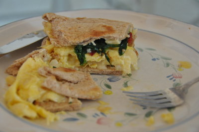 Pita Egg Spinach Sandwich Scrambled eggs with smoked gouda, sauteed sesame seeds and spinach, and cranberries Rating: 5 stars Cost: $2