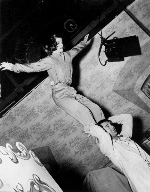 Katharine Hepburn & Cary Grant practice their somersault scene on the set of Holiday (1938) (via getty archives)