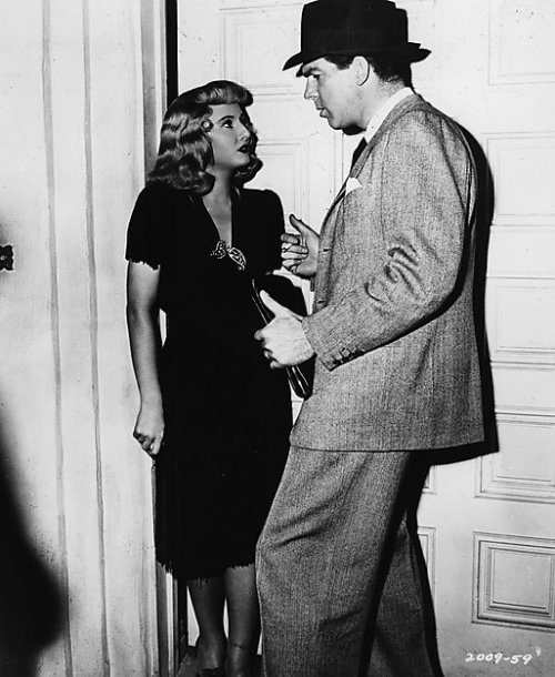 "Barbara Stanwyck & Fred MacMurray on the set of Double Indemnity (1944) ""I was lucky enough to make four pictures with Barbara. In the first I turned her in, in the second I killed her, in the third I left her for another woman, and in the fourth I pushed her over a waterfall. The one thing all these pictures had in common was that I fell in love with Barbara Stanwyck - and I did, too."" -Fred MacMurray"