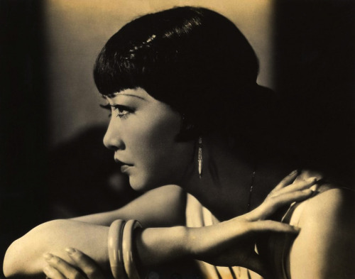 "Anna May Wong (circa 1930s) Her resume would be impressive enough for a Caucasian actress. It happened that Anna May Wong was Chinese, at a time when East Asians were no more likely to become Hollywood stars than someone from India or Africa. She knew, from seeing The Perils of Pauline serials with the villainous Wu Fang, or D.W. Griffith's Broken Blossoms, about a sensitive, opium-sotted ""Chink,"" that Chinese were portrayed in films as notorious criminals or emotional cripples, and that, anyway, they were almost always played by white actors. Hollywood may as well have had a sign on the studio gate reading No Chinese Need Apply. But Wong did; she was merely following her dream to be a star.  She was too young and ambitious to know it couldn't be done. So she did it. -excerpted from That Old Feeling: Anna May Win by Richard Corliss (TIME), a very good profile of Wong & her film career"