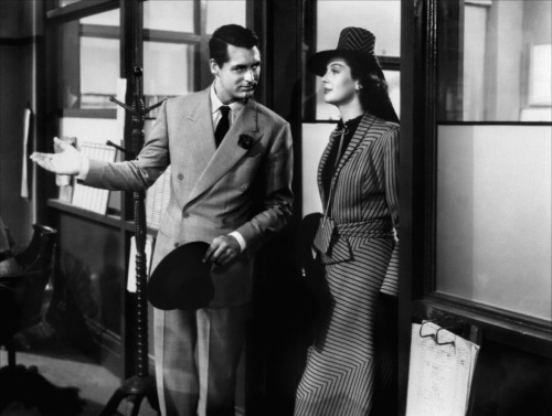 "Cary Grant & Rosalind Russell in His Girl Friday (1940) (via drmacro) Excerpted from Life is a Banquet by Rosalind Russell (and Chris Chase): [His Girl Friday director Howard Hawks] had been watching Cary and me for two days, and I'd thrown a handbag at Cary, which was my own idea, and missed hitting him, and Cary had said, ""You used to be better than that,"" and Hawks left it all in. It's a good director who sees what an actor can do, studies his cast, learns about them personally, knows how to get the best out of them. You play the fiddle and he conducts. I think filming the scene is the easiest thing. It's preparing for it, rehearsing with it, trying to get at the guts of it, trying to give it meaning and freshness so that the other actor will relate to you and think of you as his mother or his wife or his sister, rather than just reciting lines, that's the actor's real work. A good director knows how to help you with it. Grant…could immediately go off into a spin and become any character that was called for. He was terrific to work with because he's a true comic, in the sense that comedy is in the mind, the brain, the cortex. (Every actor you play with helps you or hurts you, there's no in between. It's like tennis, you can't play alone or with a dead ball; and a lot of pictures fail right on the set, not in the script, where they say it starts. A group of actors and a director can wreck a good script; I've seen it happen.) Cary loved to ad lib. He'd be standing there, leaning over, practically parallel to the ground, eyes flashing, extemporizing as he went, but he was in with another ad-libber. I enjoyed working that way too. So in His Girl Friday we went wild, overlapped our dialogue, waited for no man. And Hawks got a big kick out of it. Hawks was a terrific director; he encouraged us and let us go. Once he told Cary, ""Next time give her a bigger shove onto the couch,"" and Cary said, ""Well, I don't want to kill the woman,"" and Hawks thought about that for a second. Then he said, ""Try killin' 'er."""