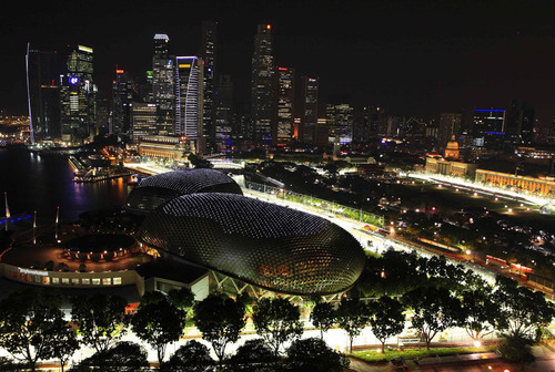 "interstate:  Asian cities (this is Singapore) are just plain cooler looking than Western ones.  And they're going to keep getting cooler. I like tall skyscrapers - only Chicago and New York really pull them off well in all of ""the West"". Click through for some cool pictures of the Singapore Grand Prix, which they ran entirely at night."