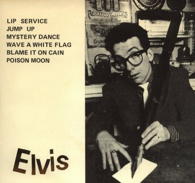 last month's three elvis costello EP covers (and video) were probably enough, but this one has a giant pen, so there you go.