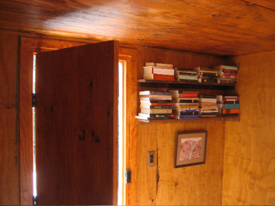 "James Benning Kaczynski cabin interior Ted Kaczynski Cabin, built April 2008- June 2008Dimensions: outside: 12'1"" x 10'2"", peek: 12'9""inside: 10'5"" x 9'4"", ceiling: 81""2 windows: 18"" x 18"", left 59"" off floor, 30"" from rear right 39"" off floor, 44"" from frontDoor: 76"" x 26"", front, centered"