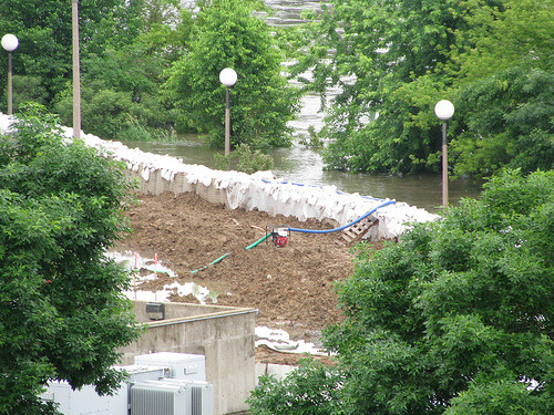 Sandbag levee (via mgbales) Many people, of course, would probably not be terribly sad to lose the Laser Center, Gehry or not. The protests when it went up were huge.
