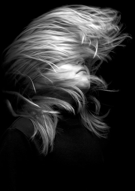 Fun, studio shot of little girl tossing hair.