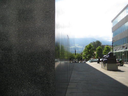Kunstmuseum Liechtenstein.  this is freaking incredible in person.  it is polished to be so smooth and the window detail makes the entire facade completely flat.  it almost disappears into the sky.
