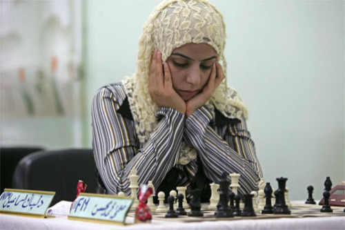 somerset: Iraqi chess player Delbak Ismail contemplates her next move during the Iraq chess championship on August 6, 2009 in Baghdad, Iraq.