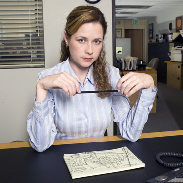 "Essentially, I'm Pam from ""The Office"". I'm the receptionist at a paper company, I play endless amount of FreeCell at work, and I am extremely nearsighted. But I have still yet to get banned from Chili's, participate in the Office Olympics, or find my own Jim. One day."
