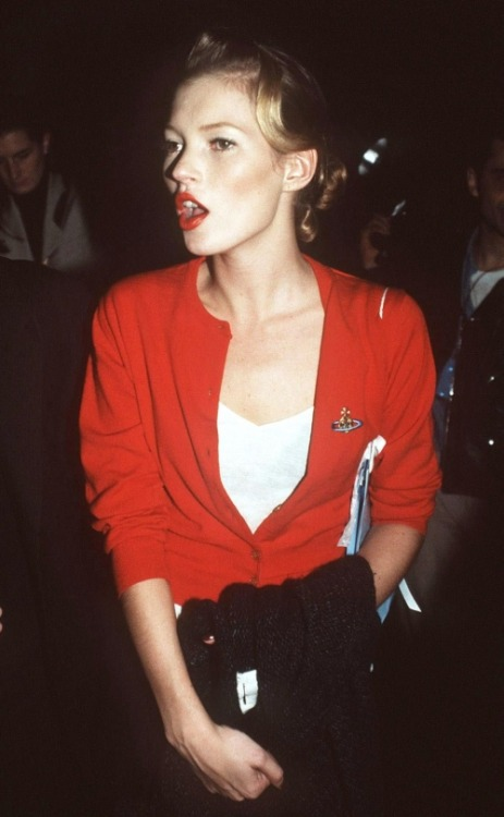 pineappleupsidedown: Kate Moss wearing a cute Vivienne Westwood cardigan backstage at a Westwood show