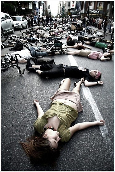 danij12:  This was in protest of the death of a cyclist on Montreal street who was hit by a motorist.It was incredible. Rue Ste. Catherine was shut down in the late afternoon on a Saturday. Closed the city for ten minutes.It was beautiful. I would say that it made a lot of Montreal motorists angry, but that would mean the protesters really had no effect Artist: Kreddible Trout