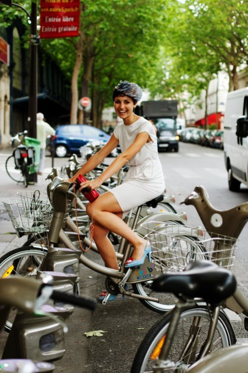 I used Velibs several times last weekend in Paris. While some of the bikes were in bad shape and at other parking lots there were none left, it is a great idea. pinkhotel: Via The Sartorialist