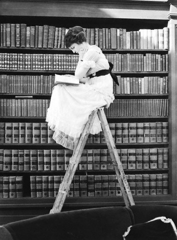 Woman reading on top of ladder, c.1920© Bettmann/CORBIS [thanks for reminder,Alex;]