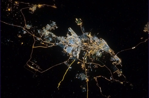 colchrishadfield:  The busy Saudi port city of Dhahran, and the bridge to Bahrain. An incredible sea of humanity, as-seen from space.