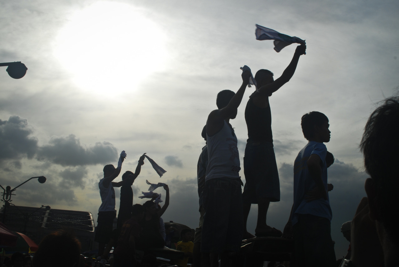 gettyimages:  Filipinos Revere The Black Nazarene Black Nazarene devotees cheer from rooftops during the 406th feast of The Black Nazarene on January 9, 2013 in Manila, Philippines. Devotees march barefoot as a sign of sacrifice during the procession as the Black Nazarene is carried in turn through Manila's thoroughfares. The dark wood sculpture of Jesus was brought to the Philippines in the 1600s by Spanish missionaries from Mexico to the Philippines and is revered by Catholic devotees who claim the statue possess miraculous powers. Security authorities monitoring the day long procession estimated the crowd at around 2 million people at its peak. Photo by Dondi Tawatao/Getty Images