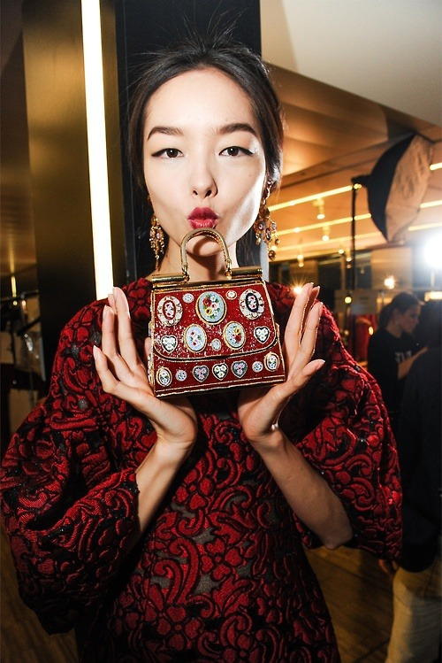 Fei Fei Sun backstage at Dolce & Gabbana Fall 2013 in Milan.