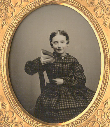 ca. 1858, [ambrotype portrait of a smiling young girl with a book] via Christopher Wahren Fine Photographs, Skylight Gallery